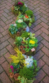 Natural Planted casket arrangement.